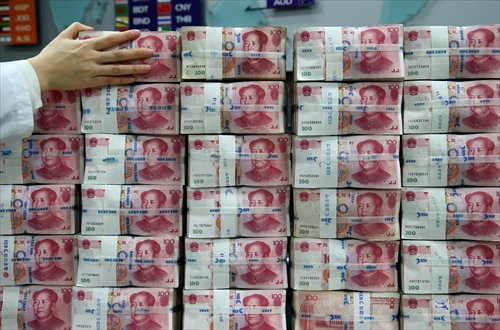 Chinese one-hundred yuan banknotes are stacked for a photograph at the Korea Exchange Bank headquarters in Seoul, South Korea, on Thursday, Feb. 27, 2014. Photographer: SeongJoon Cho/Bloomberg
